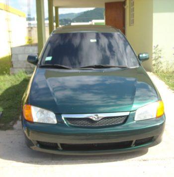 Mazda Protege 2000 usado ubicado en San Salvador Vendo carro Mazda Protege año 2000, color verde en buen estado, con pequeños detalles